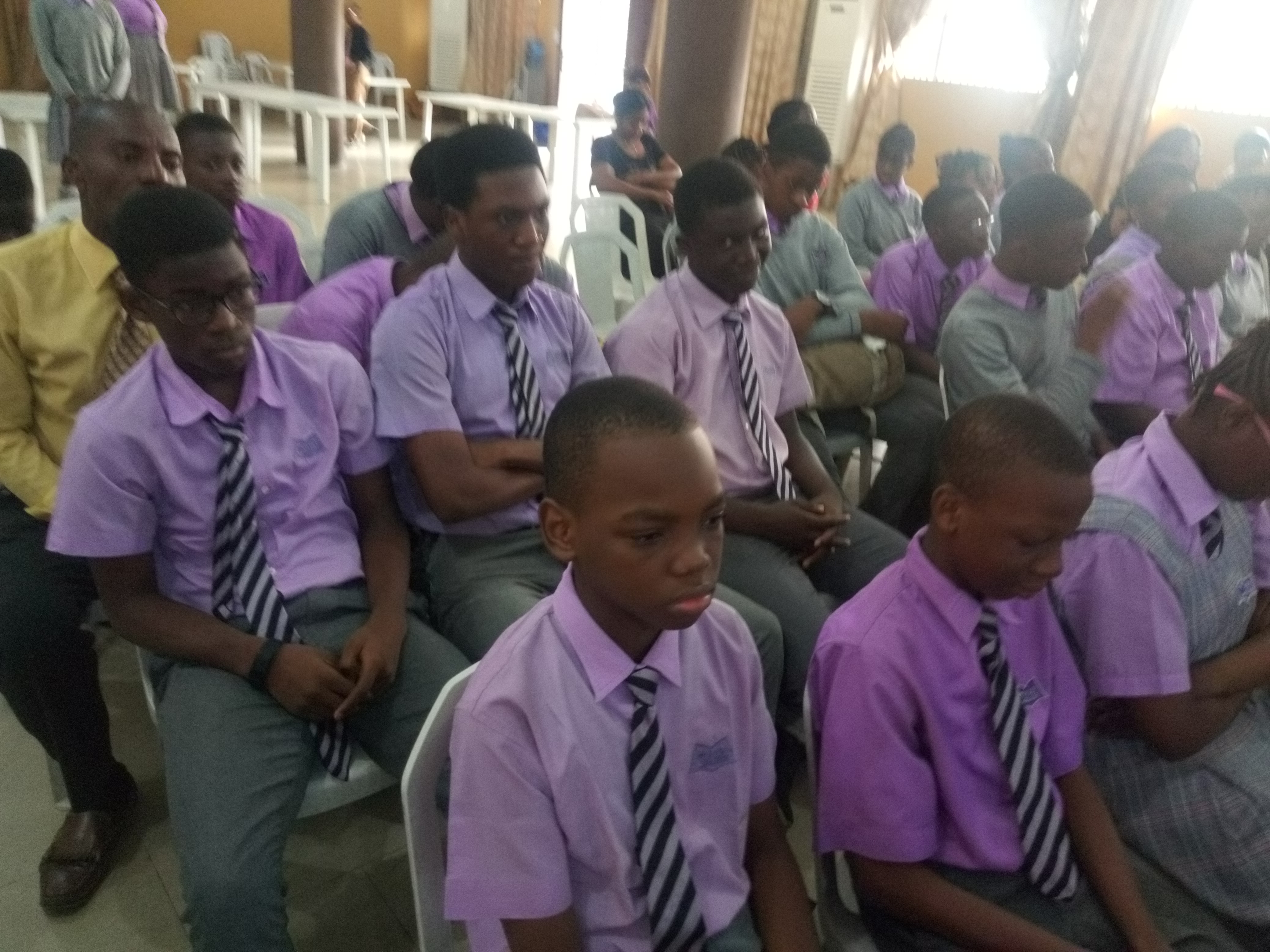 STUDENTS LISTENING ATTENTIVELY TO HEALTH TALK